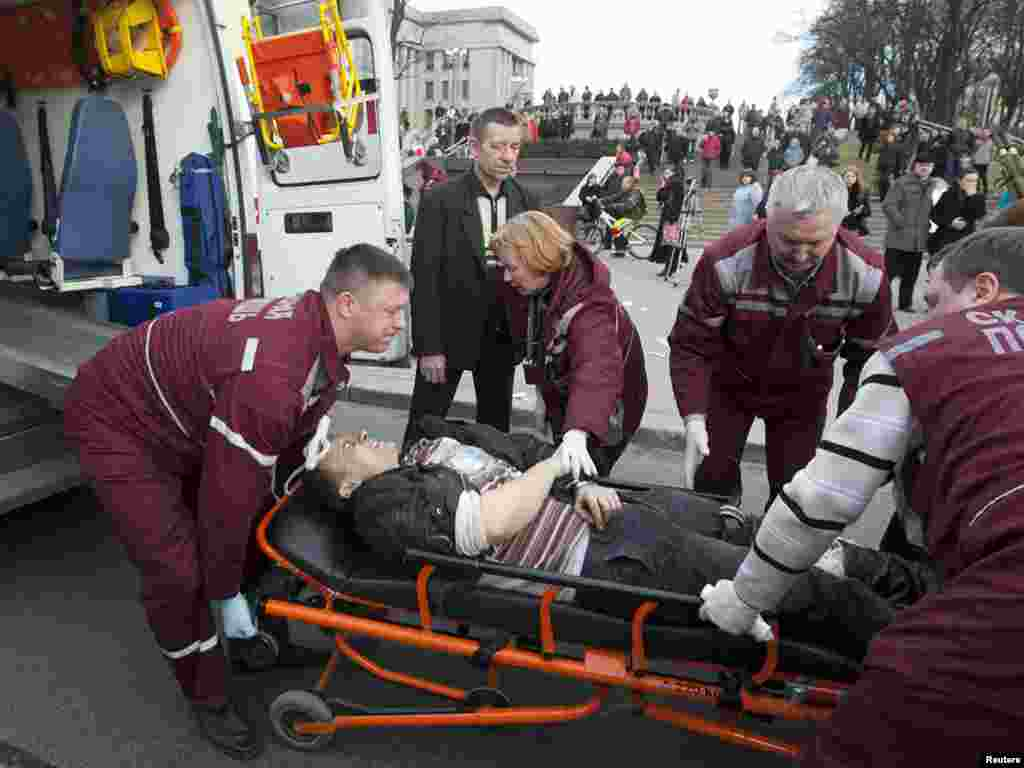 Medics lift a victim of the blast into an ambulance.