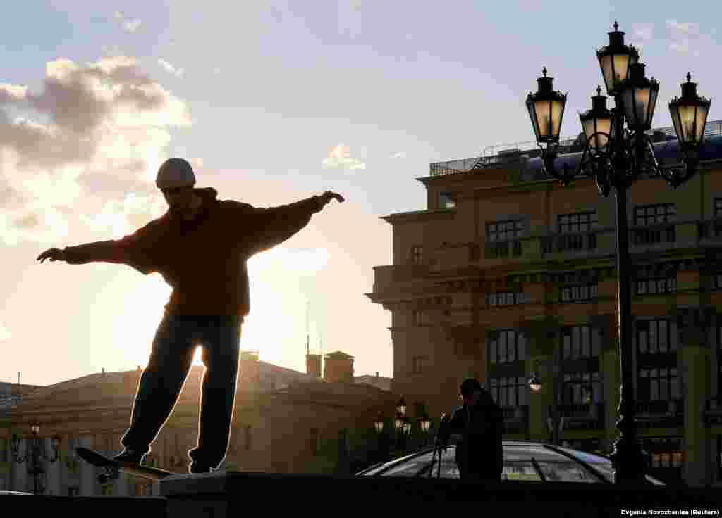 A skateboarder performs a trick in Manezh Square in central Moscow. (Reuters/Evgenia Novozhenina)