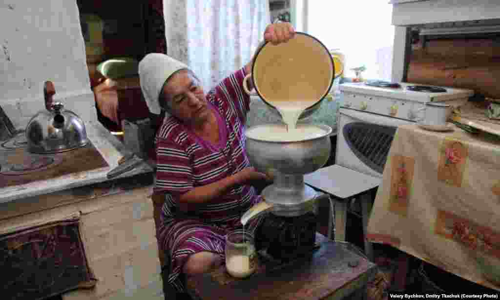 A woman makes cream in her kitchen.
