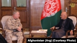 FILE: General Kenneth McKenzie, the head of U.S. Central Command meeting Afghan President Ashraf Ghani in Kabul.