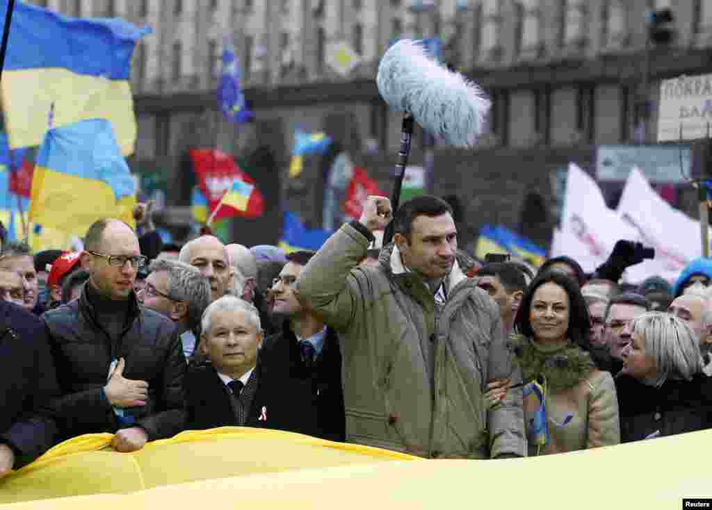 Opposition leaders attend the rally in Kyiv. From left to right. Arseny Yatsenyuk, a Ukrainian opposition leader; Jaroslaw Kaczynski, leader of Poland's main opposition Law and Justice Party and Vitali Klitschko, heavyweight boxing champion and UDAR (Punch) opposition party leader.