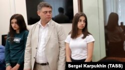 Maria (left) and Angelina (right) Khachaturyan attend a court hearing in Moscow on June 26.