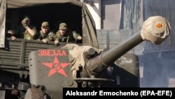 Separatist forces take part in exercises on a shooting range near Luhansk.