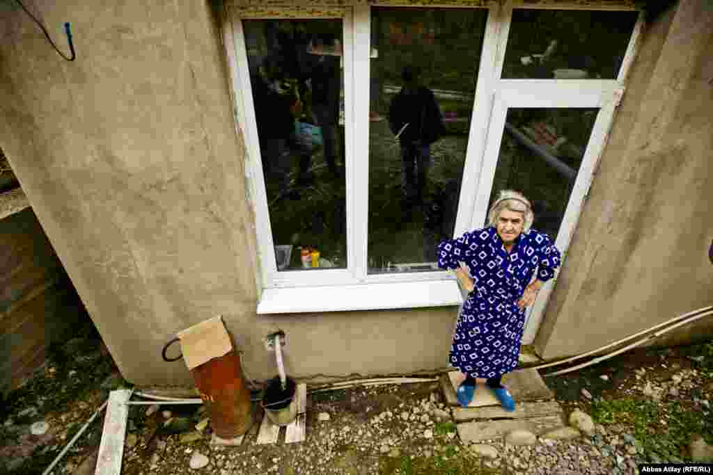 Polina Kalayzhan, 75, lives next door to Abzhan. She says that her house is slowly sliding down the hill and floods every time it rains.