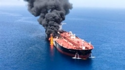 AR SEA -- An oil tanker is seen after it was attacked at the Gulf of Oman, June 13, 2019