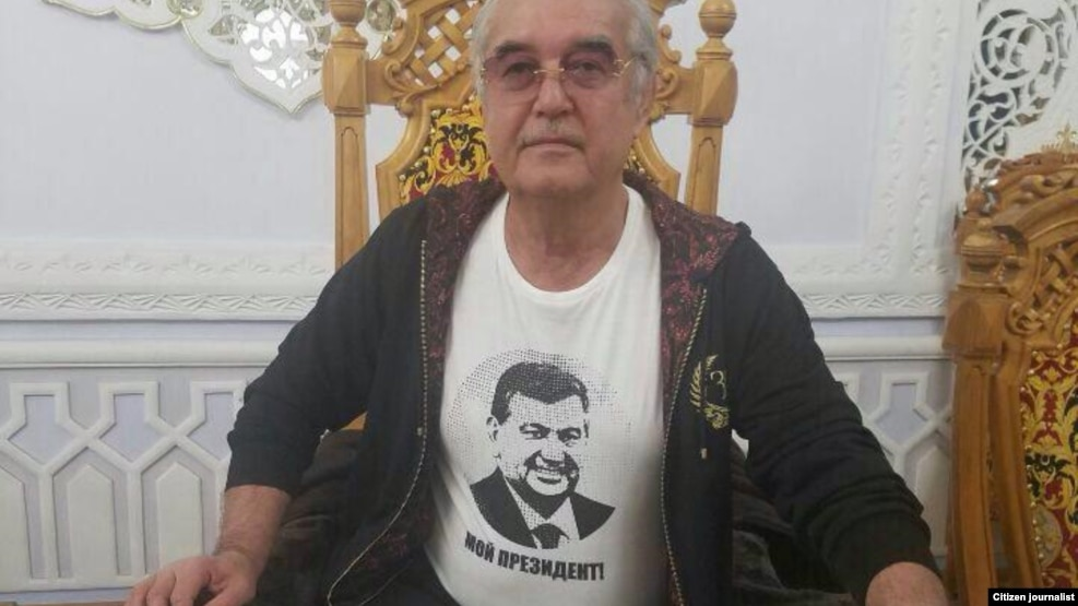 "Salimbay Abdullaev, the new deputy chief of Uzbekistan's National Olympic Committee, wears a T-shirt bearing the face of Shavkat Mirziyaev that says ""My President."""