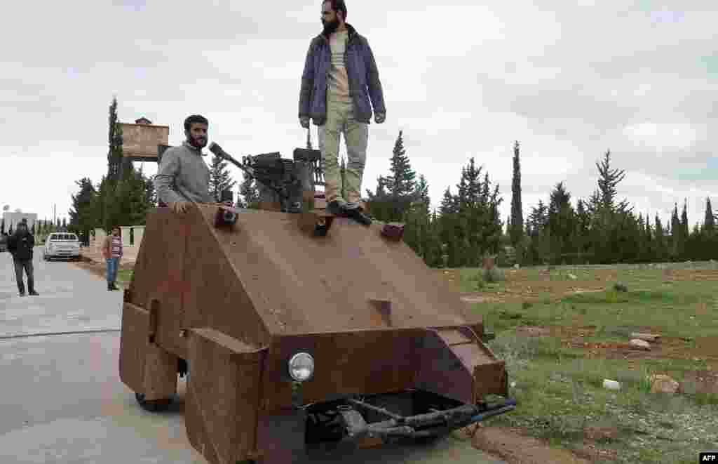 "From a distance, it looks rather like a big rusty metal box. Closer inspection reveals the latest achievement of the Syrian rebels: A homemade armored vehicle waiting to be deployed. Sham II, named after ancient Syria, is built from the chassis of a car and touted by rebels as ""100 percent made in Syria."""