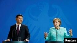 Kancelarja gjermane Angela Merkel dhe presidenti kinez, Xi Jinping