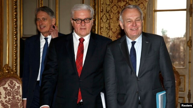 French Foreign Minister Jean-Marc Ayrault, German Foreign Minister Frank-Walter Steinmeier, and British Foreign Secretary Philip Hammond