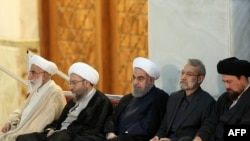 (R-L) Hassan Khomeini, grandson of Ayatollah Ruhollah Khomeini, Parliament Speaker Ali Larijani, Iranian President Hasan Rouhani, Judiciary Chief Sadegh Larijani and Iran's head of the Assembly of Experts.