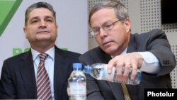 Armenia - Prime Minister Tigran Sarkisian (L) and U.S. Ambassador John Heffern attend a conference on pension reform, Yerevan, 21Feb2014.