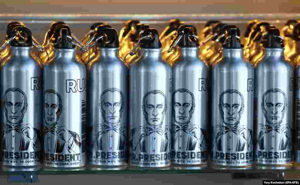 Water bottles bearing portraits of Russian President Vladimir Putin were on sale during the anniversary ceremony of the Panorama-360 viewing platform on the 89th floor of the Federation Tower in Moscow on April 17. (epa-EFE/Yuri Kochetkov)