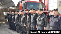 ثلة من رجال الاطفاء ومنتسبي اجهزة الدفاع المدني في ذي قار