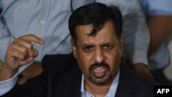 Former Mayor of the southern Pakistan city of Karachi Mustafa Kamal gestures while speaking to media representatives after his return from self-imposed exile in Karachi on March 3.