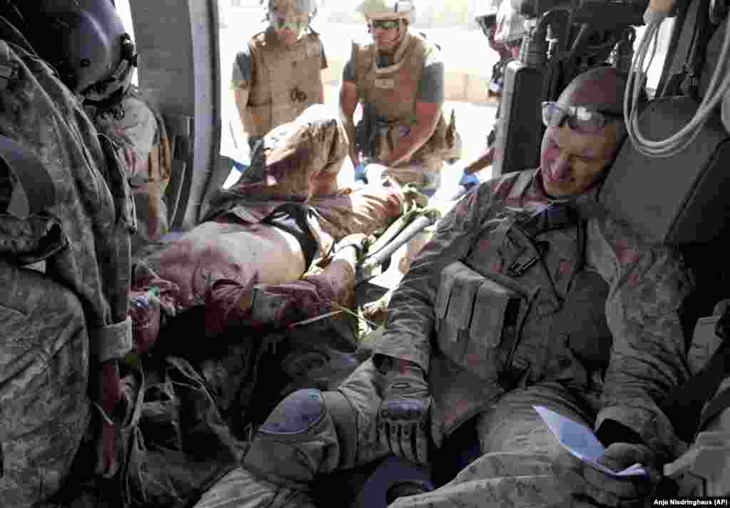 An injured U.S. Marine is carried out of a helicopter June 4, 2011 in Afghanistan.
