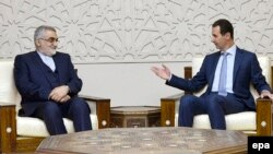 Syrian President Bashar al-Assad (R) meets with Alaeddin Boroujerdi, the head of the Iranian parliament's National Security and Foreign Comittee, in Damascus, January 4, 2017