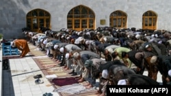 Worshippers offer Friday prayers on the first day of the Muslim holy month of Ramadan at Pul-e Khishti mosque in Kabul on April 24.