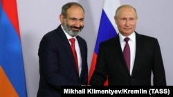 RUSSIA -- Armenian new prime minister Nikol Pashinian (L) meets with Russian President Vladimir Putin in Sochi, May 14, 2018