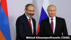 New Armenian Prime Minister Nikol Pashinian (left) with Russian President Vladimir Putin in Sochi on May 14.
