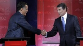 Mitt Romney (left) and Rick Perry shake hands after a debate in September.