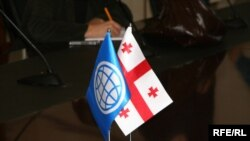 Georgia -- World Bank (L) and Georgian Flags, Tbilisi, 20Oct2009