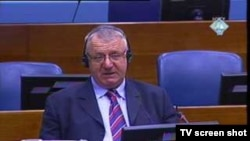 A TV grab shows Vojislav Seselj at a war crimes trial in March