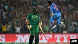 India's Hardik Pandya (R) celebrates after his dismissal of Pakistan's captain Shahid Afridi (L) during the World T20 cricket tournament on March 19.