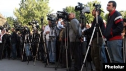 Armenia -- Television cameramen at an opposition rally in Yerevan in 2011.