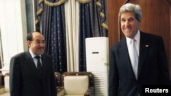 Iraqi Prime Minister Nouri al-Maliki (left) and US Secretary of State John Kerry meet in Baghdad on March 24.