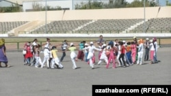 Kids rehearse for Independence Day celebrations in the eastern city of Turkmenabad.