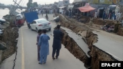 A damaged road caused by an earthquake is seen in Mirpur, in Pakistani-administered Kashmir, on September 24.