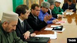 Akhmad-hadji Abdulayev is seen here on the left with then-Russian President Dmitry Medvedev in 2011.