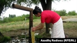 A woman washes clothes in Celebiler.