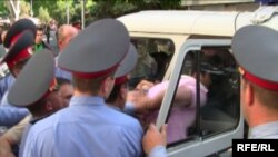 Armenia -- An opposition supporter is forced into a police vehicle near Yerevan's Liberty Square, 31May 2010.