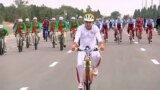 Turkmen President Gurbanguly Berdymukhammedov rides his bike in Ashgabat on June 1 as part of a mass ride that set a Guinness world record.