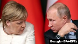 "German Chancellor Angela Merkel (left) and Russian President Vladimir Putin will discuss ""current international questions,"" a statement said. (file photo)"