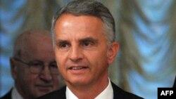 2014 жылы ЕҚЫҰ-ға төрағалық етуші Швейцарияның сыртқы істер министрі Дидье Буркхальтер.