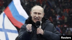 Vladimir Putin delivers a speech during the rally at Luzhniki Stadium on February 23.