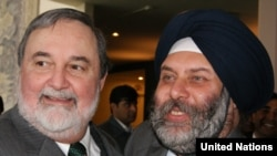 India's acting UN ambassador, Manjiv Singh Puri (right), congratulates Pakistan's UN Ambassador Abdullah Hussain Haroon upon Islamabad's election to the UN Security Council on October 21.