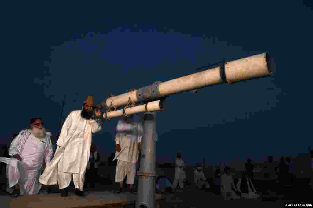 Maulana Abdul Khabeer Azad, a member of Pakistan's Ramadan moon-sighting committee, looks through a telescope for the new moon that signals the start of the Muslim fasting month of Ramadan in Karachi on April 23.