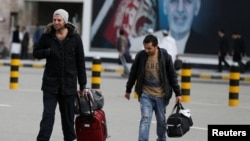 Afghans whose asylum applications were rejected arrive from Germany at Kabul airport on March 28.