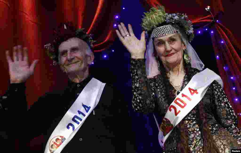 Super Grandfather Vladimer Zangurashvili, 70, and Super Grandmother Lira Arabuli, 74, wave to the audience after being crowned.