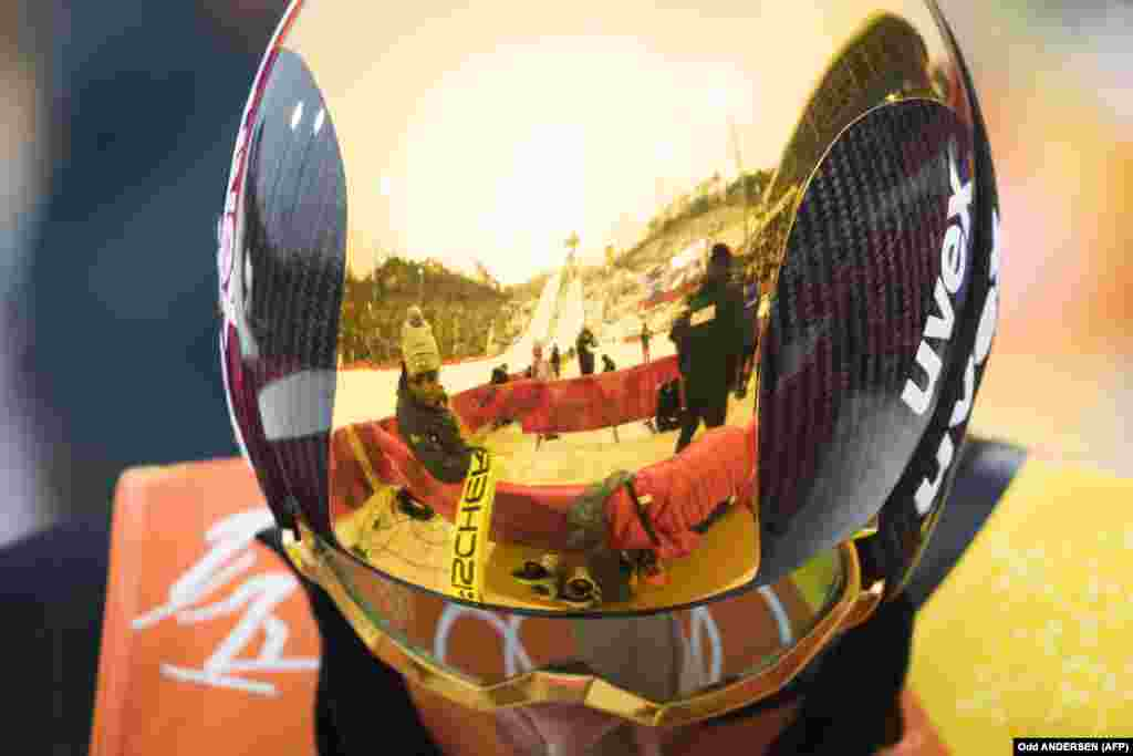 Nordic Combined: The Alpensia ski jumping centre is reflected in the golden helmet of Germany's Fabian Riessle during the nordic combined men's team Gundersen LH/4x5km Jumping competition at the Alpensia ski jump centre during the Pyeongchang 2018 Winter Olympic Games on February 22, 2018 in Pyeongchang. The team of Germany took gold in the discipline.