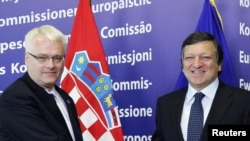 European Commission President Jose Manuel Barroso (right) and the EU are set to welcome President Ivo Josipovic's Croatia into the bloc as its 28th member.