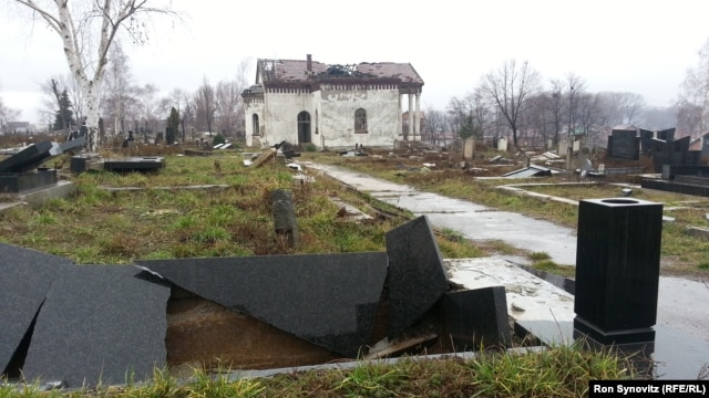 A Serbian Orthodox cemetery on a hill to the south of the Ibar River in Mitrovica lies devastated, with hundreds of headstones in shards and the chapel at its center desecrated and burned.