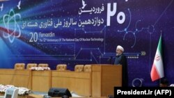 IRAN -- Iranian President Hassan Rohani (R) speaks during a ceremony to mark National Nuclear Technology Day in Tehran, April 9, 2018