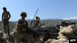 FILE: U.S. soldiers take up positions during an ongoing an operation against Islamic State (IS) militants in Achin district of Nangarhar Province in April.