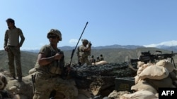 U.S. soldiers take up positions during an operation against IS militants in the Achin district of Nangarhar Province in April.