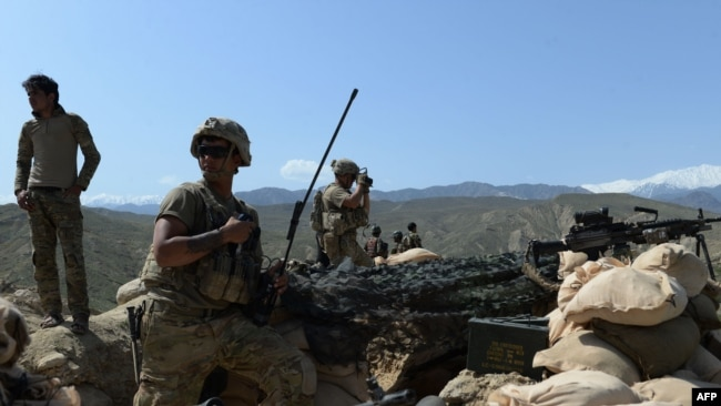 U.S. soldiers take up positions during an ongoing operation against IS militants in the Achin district of Nangarhar Province last month.