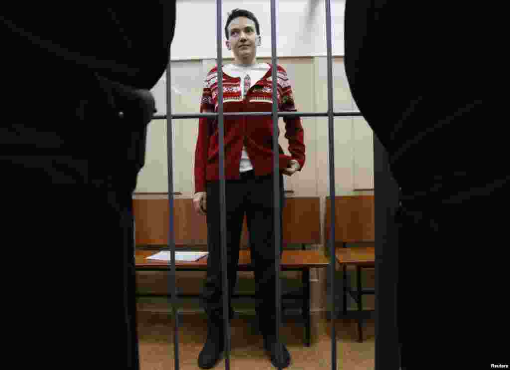 Imprisoned Ukrainian military pilot Nadia Savchenko stands inside a defendants' cage as she attends a court hearing in Moscow on March 4. She has been on a hunger strike since December 13. Savchenko was captured by pro-Russian forces and handed over eight months ago to Russia, where she was imprisoned on charges of aiding in the killing of two Russian journalists in eastern Ukraine. At home, she has become a symbol of resistance to Russian aggression. (Reuters/Maxim Zmeyev)